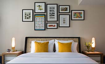 King guest room with art on the wall